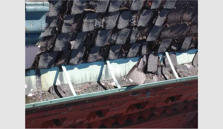 Although the asphalt shingles on the temple's roof had a slate-like color, they did not represent the original architect's rendering.