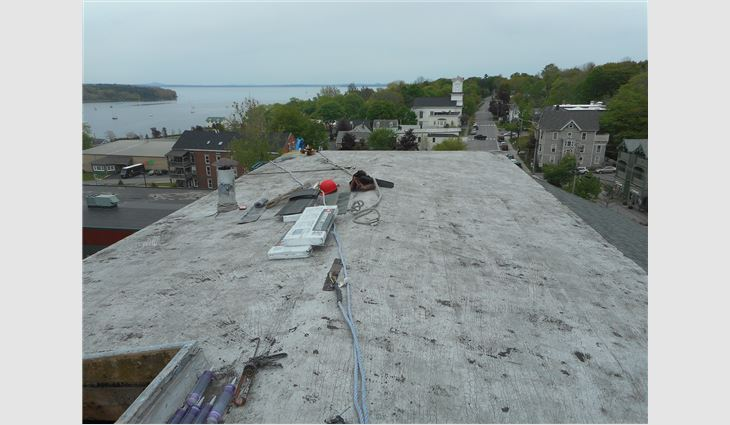 The old roof systems were removed down to the decks.