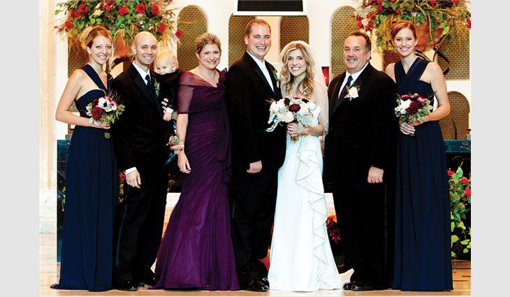 Left to right: Daughter-in-law Ashley; son Dan holding grandson Josh; wife, Bonnie; son Ryan; daughter-in-law Christen; Petrick; and daughter, Ashley, at Ryan's wedding