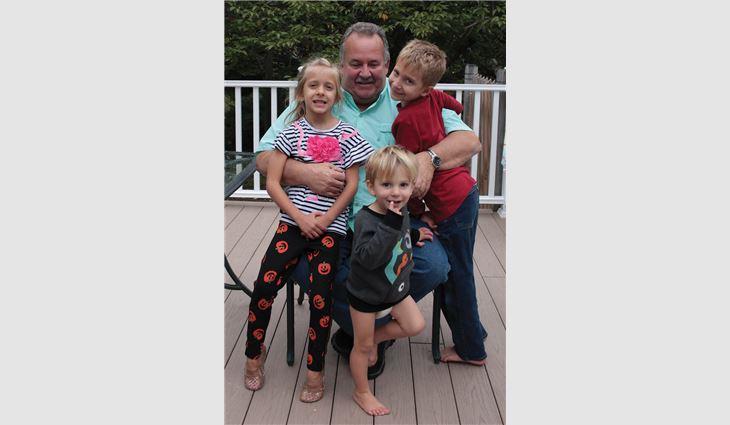 "Petrick with his grandchildren, Brooke, Jonathan and Josh, who affectionately call Petrick ""Grumpy"""