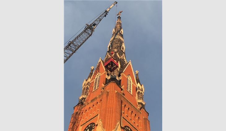 Workers used a crane to remove decorative elements to be used as molds