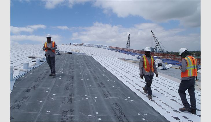 Advanced Roofing workers install DensDeck® Prime Roof Boards