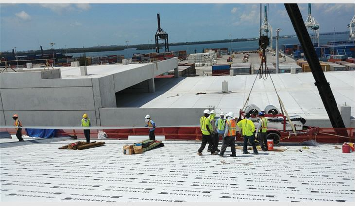 Because of tight space, materials were lifted to roof areas as they were delivered.