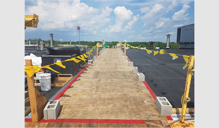 Temporary walkways were constructed to protect the existing rooftop from further damage.