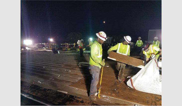 The night-shift team removed materials and prepped the roof for the second-shift team.