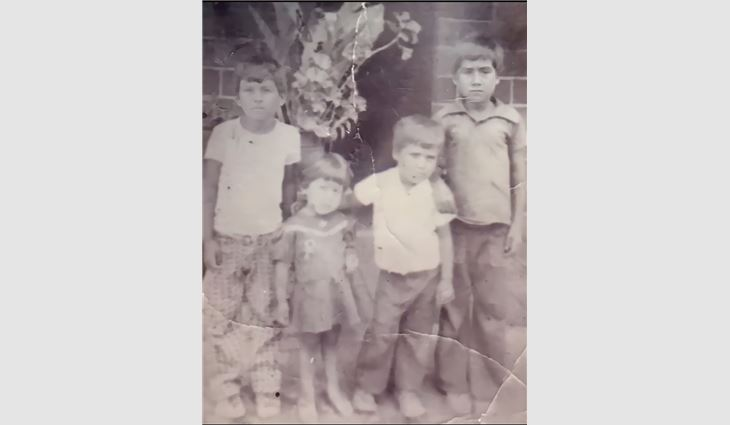 The only known childhood photo of López, pictured on the far left, with his three siblings