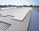 Retrofit with high R-value insulation - Reroofing with high R-value insulation can provide energy savings