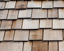 Caring for wood roof systems - Wood shakes and wood shingles require specialized maintenance