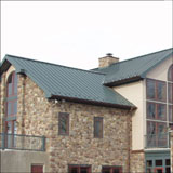 A good match - Donald B. Smith Roofing Inc. installs a metal roof system on a stone home