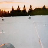 Night shift - Madsen Roof Co. Inc. performs nocturnal roof system maintenance
