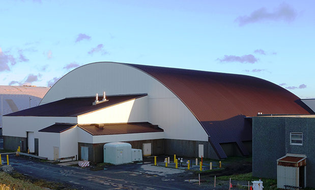Reroofing the last frontier - Rain Proof Roofing restores the roof on Eareckson Air Station's Hangar 6 in Alaska