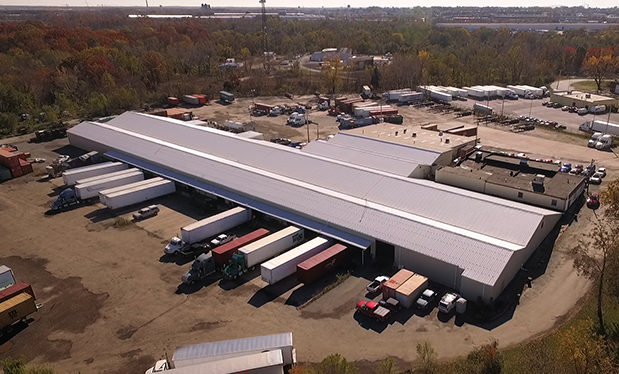 Big rig roofing - Moser Roofing Solutions retrofits new metal panels on O.S.T. Trucking's warehouse