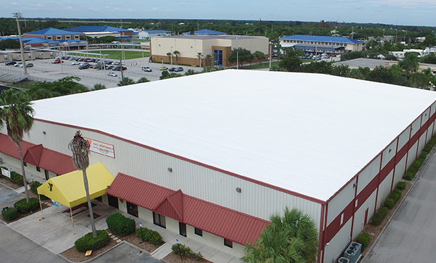 A roofing treasure - Venture Construction Group of Florida helps repair storm-damaged roofs at the YMCA of the Treasure Coast in Florida