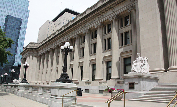 Roofing is now in session  - Blackmore & Buckner Roofing restores multiple roof systems on the Birch Bayh Federal Building and U.S. Courthouse