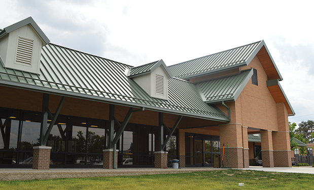 Four-legged roofing - Wm. Molnar Roofing installs new roof systems for Leader Dogs for the Blind