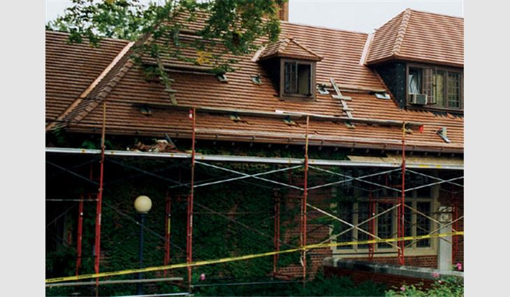 Scaffolding was erected around the Cranbrook House's west wing to protect workers and building occupants.