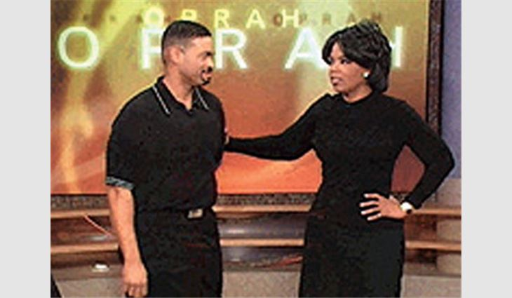 Hughes with Oprah Winfrey.