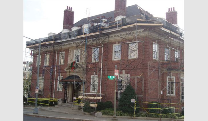 The entire building had to be scaffolded with safety netting below the walkboards and on the safety railings.