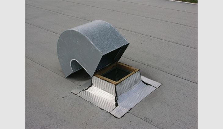 Photo 3: This gooseneck vent was attached with only two small screws. For a critical facility with a 30-foot roof height and a basic wind speed of 90 mph, FEMA 577 recommends attaching such a vent with eight No.12 screws. A substantial amount of water entered the building during passage of a slow-moving hurricane. Winds were in the range of 100