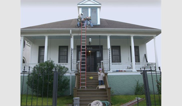 Volunteers from the Metal Construction Association reroof the rectory at St. Maurice Church in New Orleans' Lower Ninth Ward.
