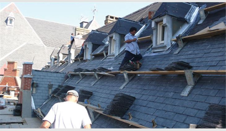 Properly loading the slate allowed for easier installation of the new roof system.