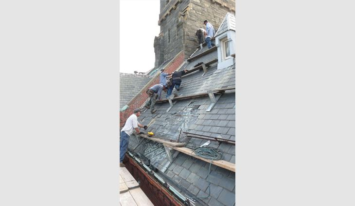 Tear-off of the existing slate roof system included temporary weatherproofing and slideguards.