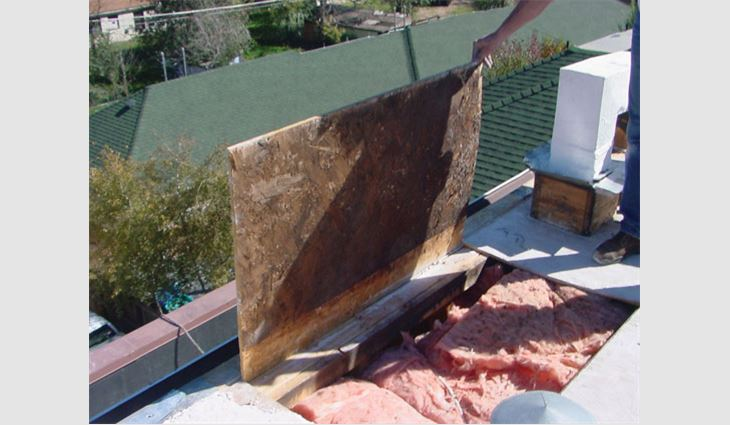 Photo 3: Condensation developed on the underside of roof sheathing in this low-slope roof assembly in a heating climate.