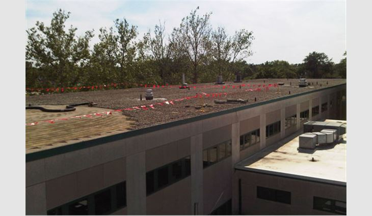Wilson Middle School's existing roof system before R.K. Hydro-Vac removed the stone ballast