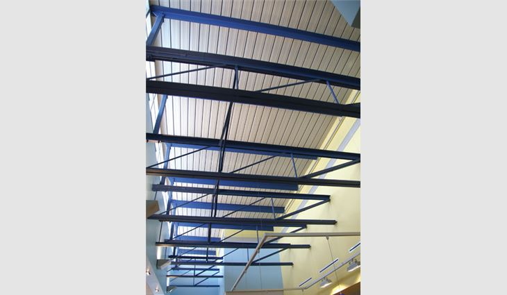 The underside of the acoustical steel deck; Wm. Molnar Roofing also performed interior sheet metal detail work.
