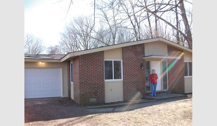 The exterior of Betty's home after Bone Dry Roofing performed renovations