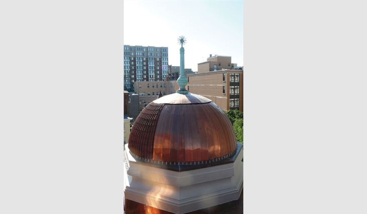 Because all the tile on the domes could not be salvaged, Wagner Roofing installed 20-ounce flat-seam copper on the rear of the domes where it cannot be seen from street level.