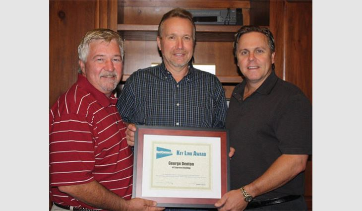 Pictured from left to right: Tim Rainey, president of Supreme Systems; Denton; and Jeff Sterrett, chief financial officer of Supreme Systems, after Denton won the RoofConnect Key Link Award