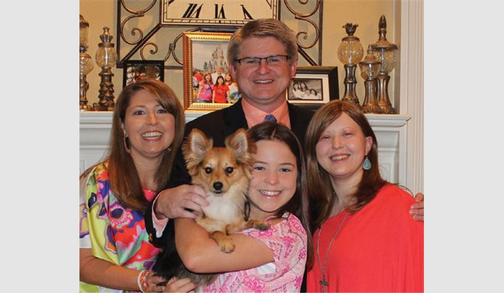 Workman with his wife, Buffy; daughters, Laura and Alicia; and dog, Max