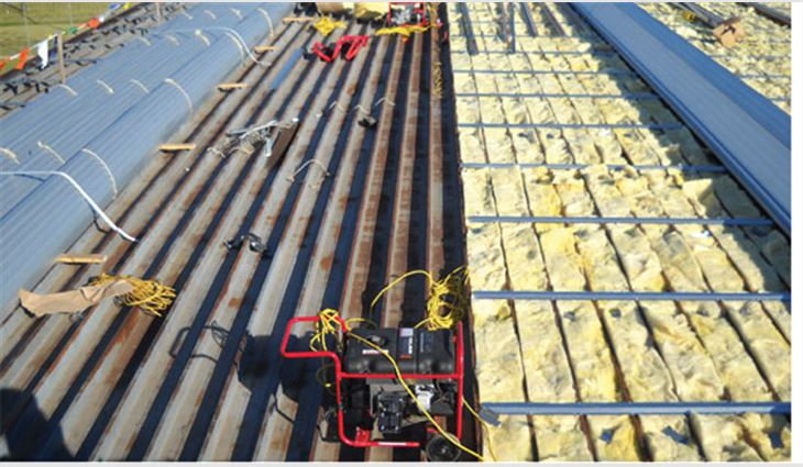 A 16-gauge engineered sub-girt system over 6-inch-thick batt insulation was applied to the existing roof system followed by 180-foot-long, 24-gauge aluminum-zinc alloy-coated roll-formed sheet-metal panels