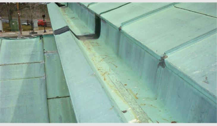 Pictured top to bottom: New 20-ounce double-locked standing-seam copper panels were formed on site; an aerial view of the completed copper roof system