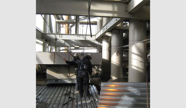 5/8-inch-thick steel cable fall-arrest systems were attached to the main structural support columns and beams