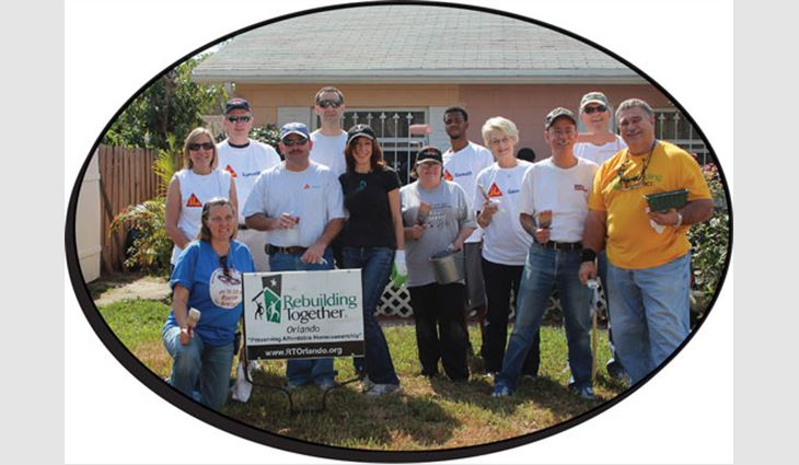 Volunteers helped renovate three homes during the International Roofing Expo's annual Community Service Day.