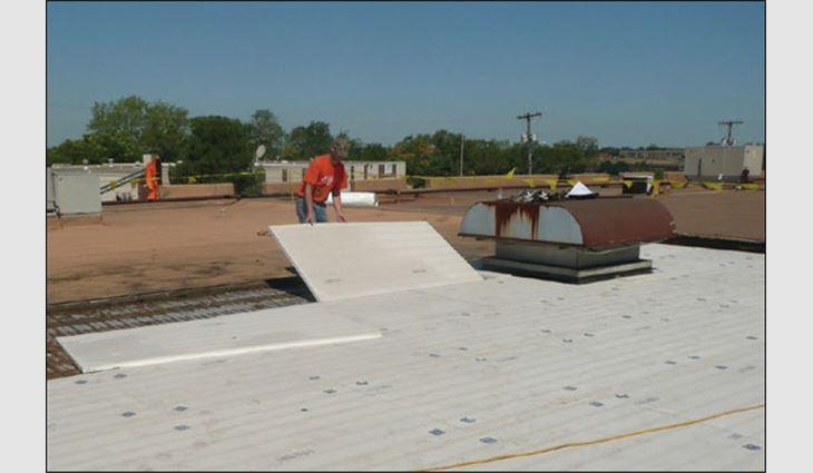 A worker installs high-density EPS insulation boards.