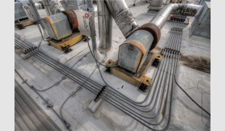 14,400 linear feet of electrical conduit was raised 1 inch before removing the old roof system and repositioned with new supports following the new roof system installation