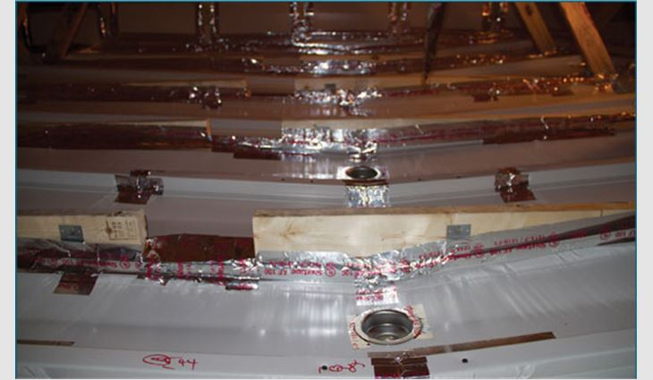 Photo 1: Water collection channels between ceiling trusses
