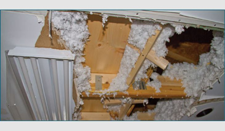 Photo 7: Collapsed ceiling in the kitchen on the duplex's unsealed roof deck side