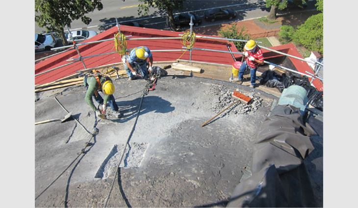 The dome's concrete deck was spalled and removed by a jack hammer.