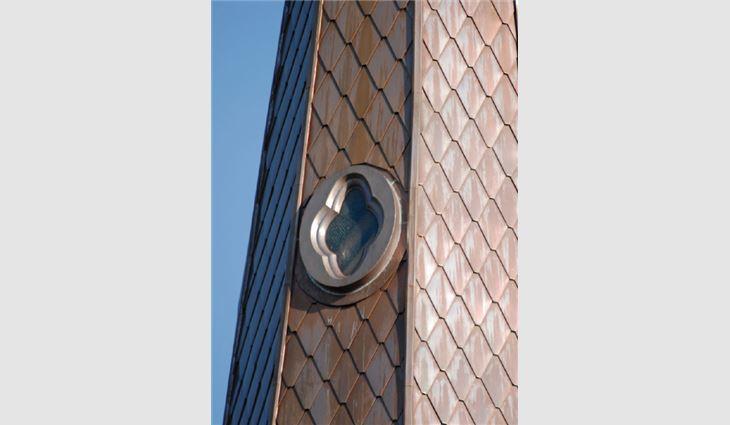 One of eight decorative custom-made copper windows