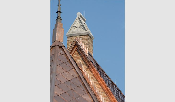 Custom-fabricated Rauten interlocking 16-ounce copper tiles were installed on the steep-slope areas