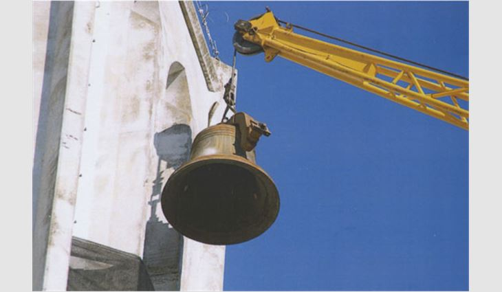 National Building Contractors Inc., Conyers, Ga., provided a crane and engineering support to help Monastery of the Holy Spirit, Conyers, remove a 1,600-pound bell for repair.