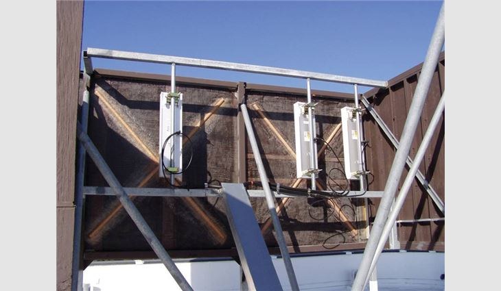 RF antennae as seen from behind the same building element at roof level.
