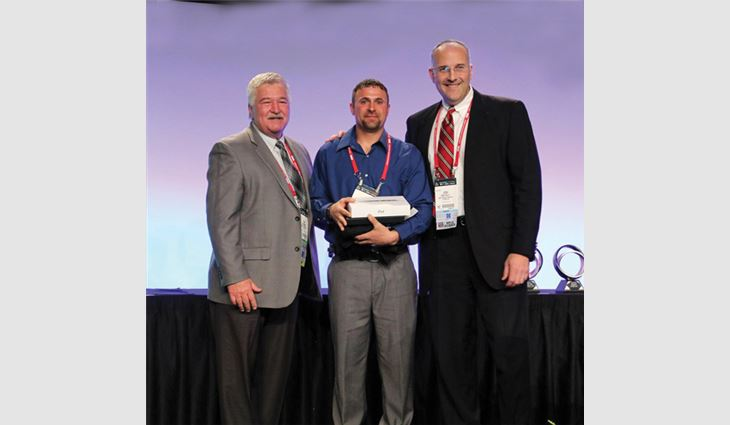 Watts (center) with Tim Rainey (left), MVP Task Force chairman, and Josh Kelly, vice president and manager of OMG Roofing Products Inc., Agawam, Mass., after Watts won the Best of the Best Award