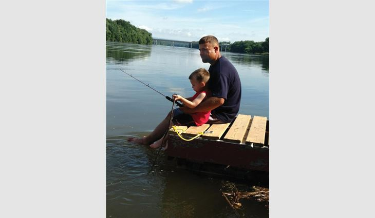 Watts fishing with his son, Bryce