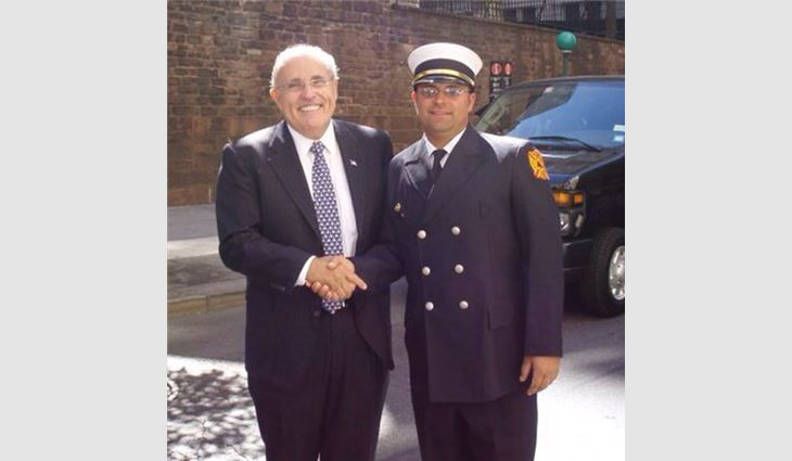 Watts with former New York City Mayor Rudy Giuliani on Sept. 11, 2010.