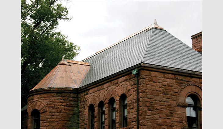 More than 200 squares of slate and multitudes of copper ridge cresting, standing-seam copper roofing, gutters and leaders were installed on Woods Memorial Hall.